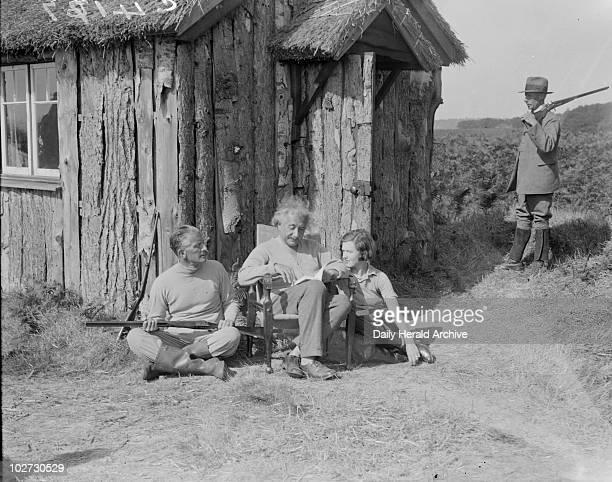 Albert Einstein German mathematical physicist 1933 Albert Einstein with Commander Oliver LockerLempson MP and a young woman Einstein the...