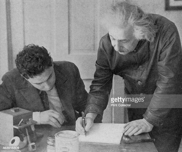 German-born theoretical physicist, Albert Einstein with a student, circa 1945. Einstein's main contribution to science was the theory of relativity,...