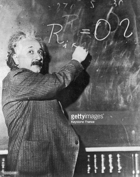 German-born theoretical physicist, Albert Einstein , writes a mathematical formula on a blackboard, 1931.