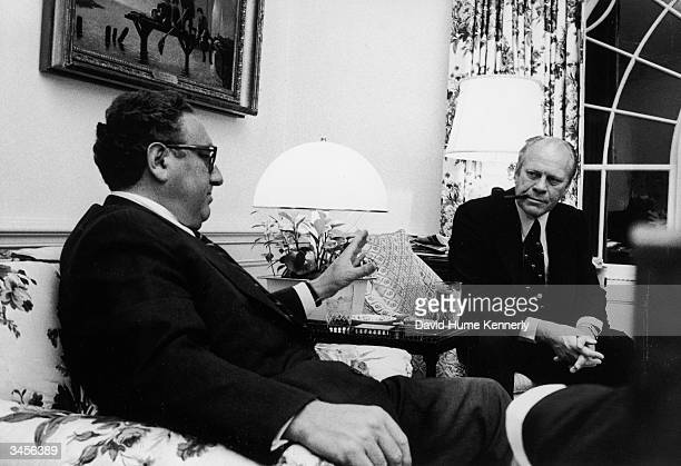 Germanborn US Secretary of State Henry Kissinger makes a point during a coversation with American President Gerald Ford at the White House Washington...