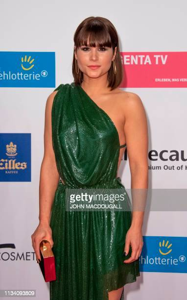 German-Brazilian actress Christina do Rego poses on the red carpet prior to the annual German film and television awards 'Golden Camera' of German TV...
