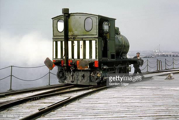German-built Arthur Koppel fireless locomotive, works No.2499 of 1907, has its steam reservoir discharged over the Thames Estuary at Empire Paper...