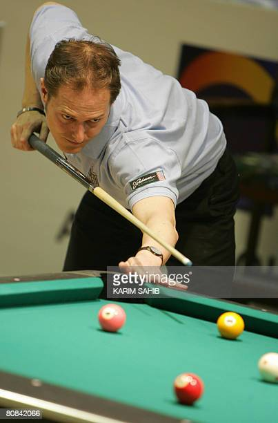 Germane Marcus Westen sets up a shot during his match against Austria's Jasmin Ouschan at the World 8Ball pool championship in the Gulf Emirate of...