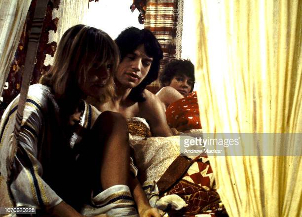 GermanItalian actress artist and model Anita Pallenberg and British singersongwriter Mick Jagger with French actress Michele Breton on the set of...