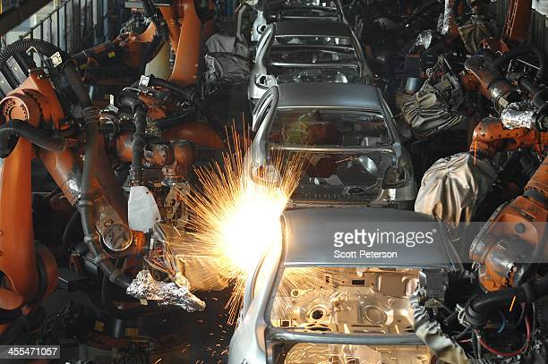 Germanmade robotic arms at the automated Iranian Khodro car manufacturing plant make Iranian car models as well as vehicles under license of the...