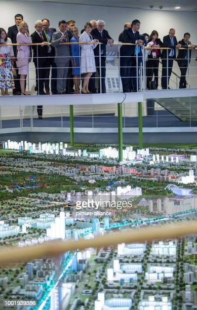 GermanPresident FrankWalter Steinmeier and his wife Elke Buedenbender take a look at the model of the city of Astana together with Astana's mayor...