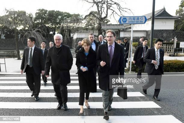 GermanPresident FrankWalter Steinmeier his wife Elke Buedenbender and Sophia University professor Sven Saaler pass the road during their visit to...