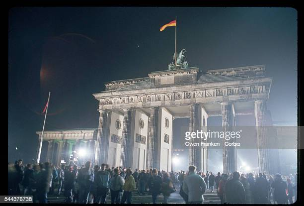 Germans celebrate New Year's Eve at the Berlin Wall and Brandenburg Gate December 31 1989