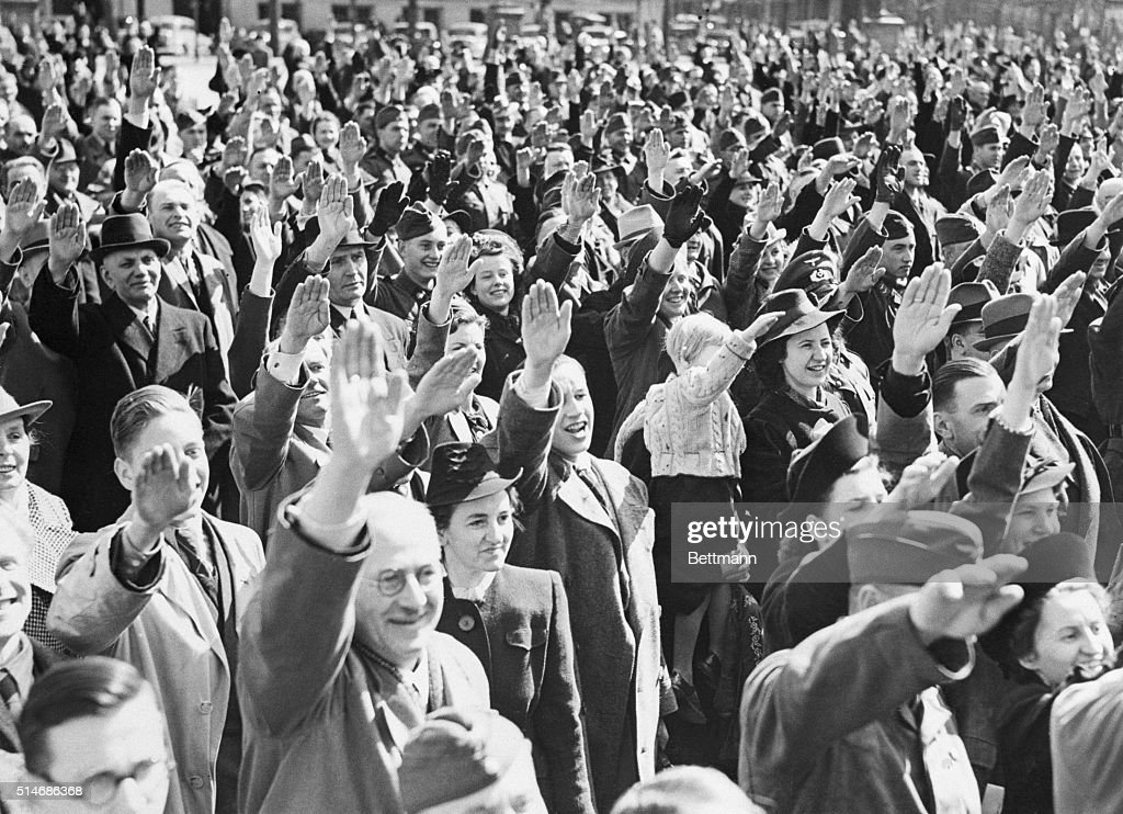 People Cheer and Salute Hitler : News Photo