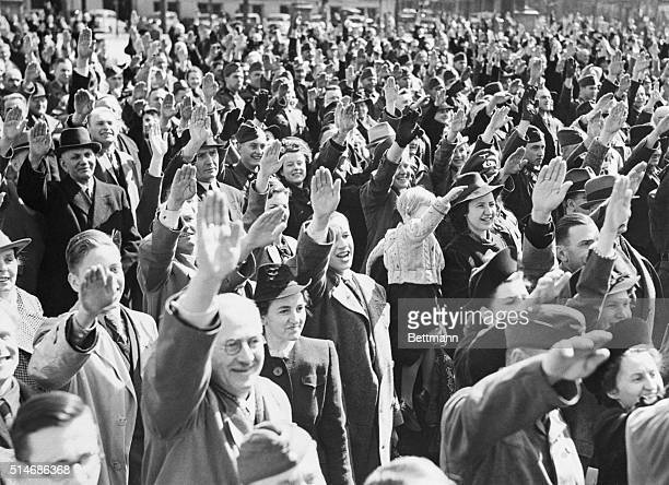 Germans cheer Adolf Hitler on his 51st birthaday as he stands on the balcony of the Reich Chancellory