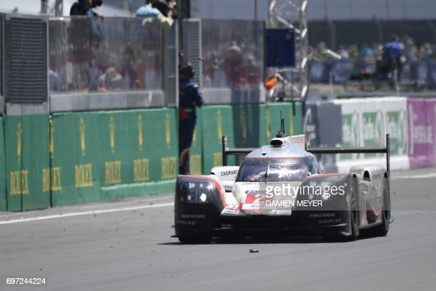 German's driver Timo Bernhard crosses the finish line on his Porsche 919 Hybrid N°2 during the Le Mans 24 hours endurance race on June 18 2017 in Le...