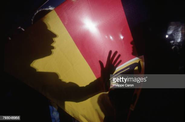 Germans gather around the flag as they celebrate the reunification of East and West Germany The previous day on October 2 the two Germanys legally...