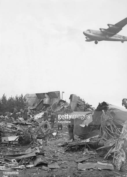 Germans in West Berlin salvage food from the wreckage of an Avro York which crashed before landing at RAF Gatow, Berlin, during the Berlin Airlift,...