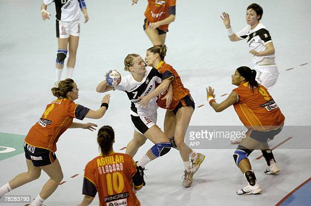 German's Nina Wrz tries to score despite Spain's Beatriz Fernandez Ibaez Macarena Aguilar Diaz Marta Mangue Gonzalez and Noelia Oncina Moreno during...