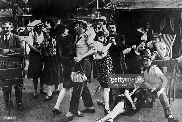 Germans people experience a perpetual holiday mood of spending and dancing during the period of inflation following Germany's defeat in World War I