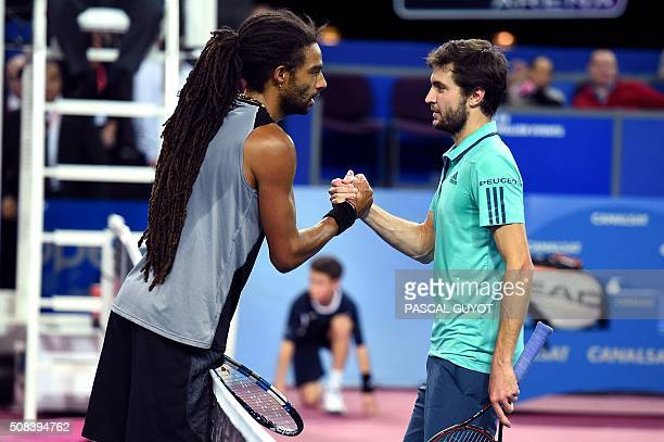 German's player Dustin Brown and French's player Gilles Simon shake hands after their tennis match at the Open Sud de France ATP World Tour in...