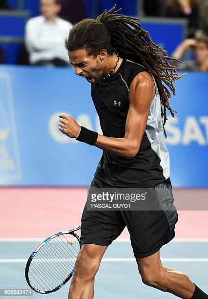 German's player Dustin Brown reacts during the tennis match against French's player Gilles Simon at the Open Sud de France ATP World Tour in...