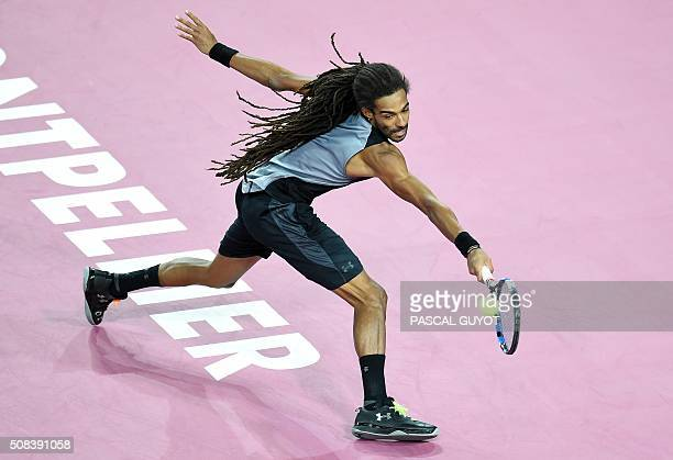 German's player Dustin Brown returns the ball to French's player Gilles Simon during their tennis match at the Open Sud de France ATP World Tour in...