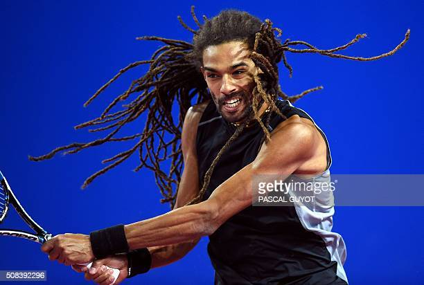 TOPSHOT German's player Dustin Brown returns the ball to French's player Gilles Simon during their tennis match at the Open Sud de France ATP World...