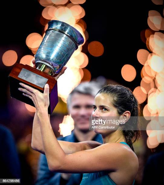 German's tennis player Julia Goerges celebrates with the trophy after the victory over Russia's Daria Kasatkina during the Kremlin Cup tennis...
