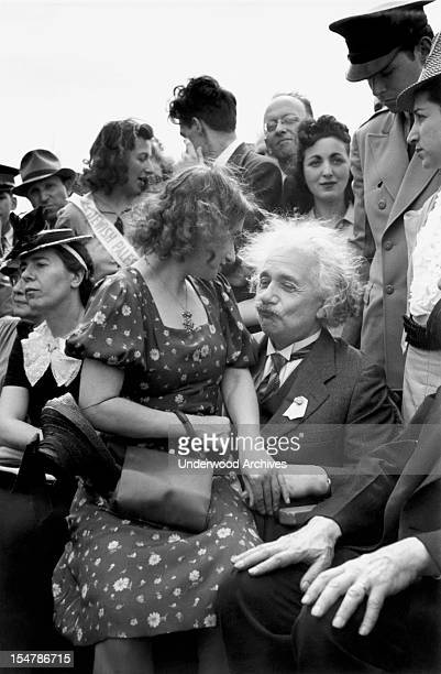 German-Swiss-American mathematician and physicist Albert Einstein , with his stepdaughter, sculptor Margot Einstein , on his lap, attends the opening...