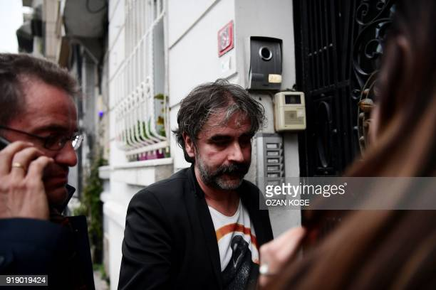 GermanTurkish journalist Deniz Yucel arrives at his hiome in Istanbul on February 16 2018 following his release from prison Turkey ordered the...
