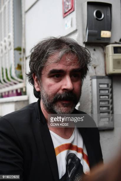 GermanTurkish journalist Deniz Yucel arrives at his home in Istanbul on February 16 2018 following his release from prison Turkey ordered the release...