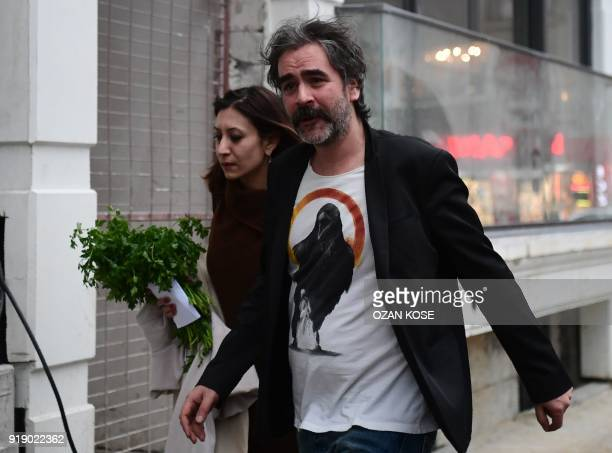 GermanTurkish journalist Deniz Yucel arrives at his home with his wife Dilek Mayatürk in Istanbul on February 16 2018 following his release from...