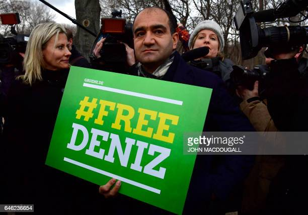 GermanTurkish politician of the Green party Ozcan Mutlu holds a placard with hashtag #FREEDENIZ to protest the detantion of German journalist Deniz...