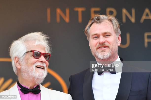 German-US producer Jan Harlan and British director Christopher Nolan pose as they arrive on May 13, 2018 for the screening of a remastered version of...