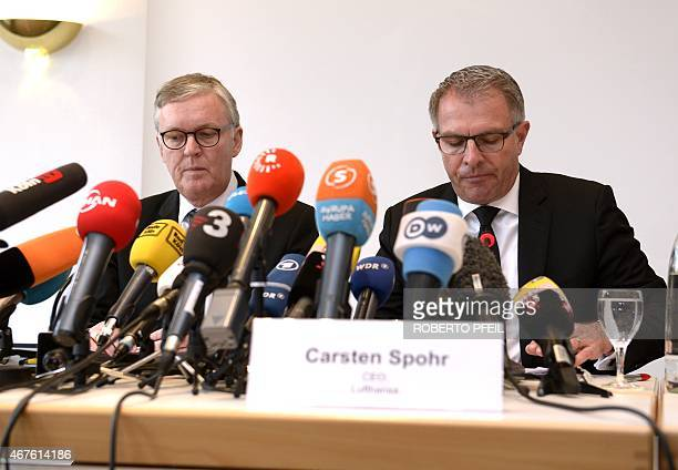 Germanwings CEO Thomas Winkelmann and Lufthansa Group CEO Carsten Spohr address a press conference in Cologne western Germany on March 26 2015 on the...
