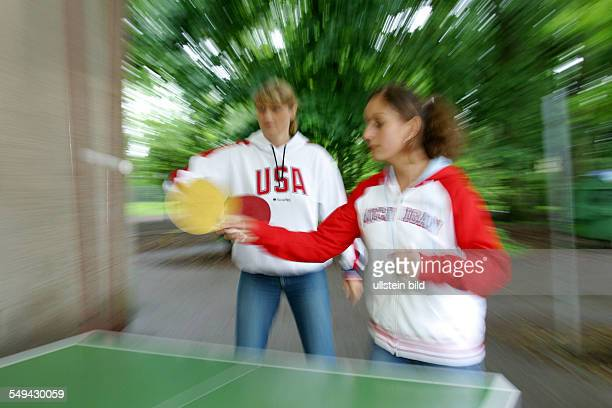 Young persons playing table tennis