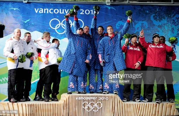 Germany 1 USA 1 and Canada 1 celebrate in the flower ceremony following the men's four man bobsleigh on day 16 of the 2010 Vancouver Winter Olympics...