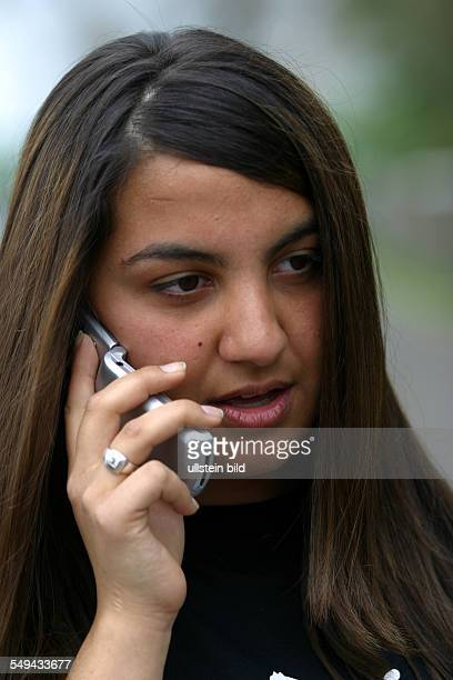 Free time Portrait of a young woman she is phoning with her mobile phone