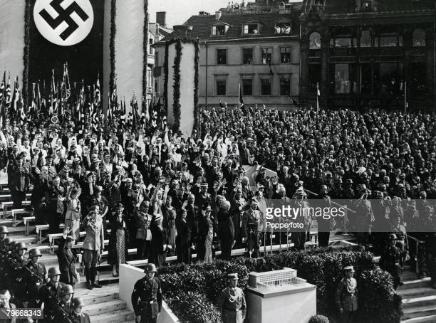 Germany 1930's Nazi leader and German Chancellor Adolf Hitler is saluted by a giant crowd of peeople as he gives a speech at a Nazi rally