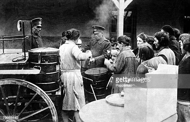 Germany 19th November German soldiers serving out food for the unemployed and destitute in their soup kitchen