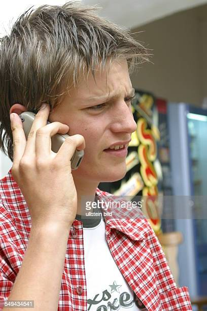 Free time Portrait of a young man he is phoning with his mobile phone