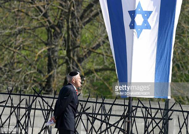 A man attending a ceremony to mark the 60th anniversary of the liberation of the Nazi concentration camp in Dachau walks past an Israeli flag 01 May...