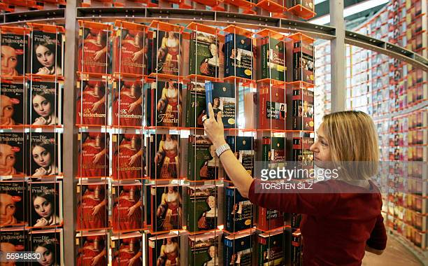 World book fair fotografas e imgenes de stock getty images a publishers associate fills books into shelves 18 october 2005 at frankfurts fairgrounds one day before gumiabroncs Image collections