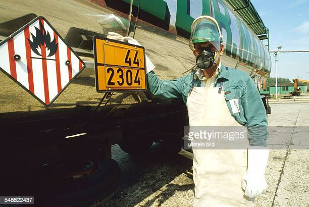 A truck driver transporting hazardous materials wearing protective clothing for unloading Naphtalin