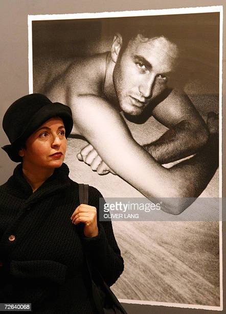 A visitor stands in front of a photograph taken by German fashion designer and photographer Karl Lagerfeld 24 November 2006 at the C/OCultural Forum...