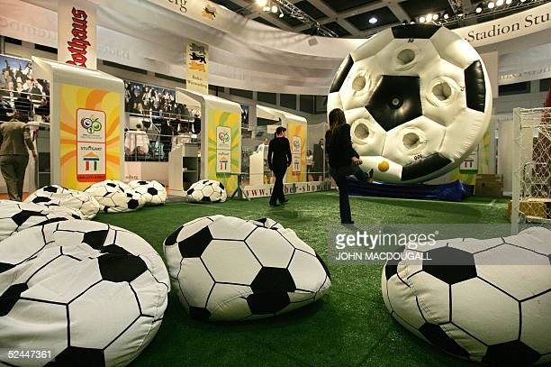 A visitor tries his luck at scoring a goal at a stand of the southern city of Stuttgart one of the 2006 Football World Cup hosting cities at Berlin's...