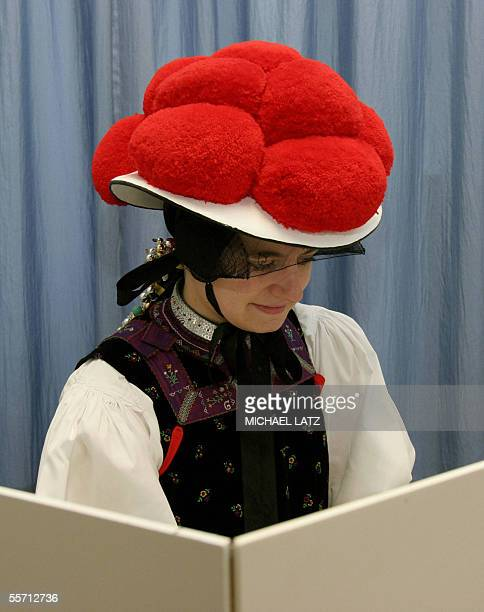 A woman in traditional clothes of the Black Forest sits in a voting booth on 18 September 2005 at a polling station in Reichenbach southern Germany...