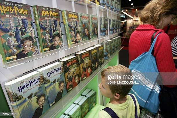 """Germany: A young boy looks at Harry Potter books on display in the """"Young Readers"""" section of the Frankfurt Book Fair, 21 October 2005. Harry Potter..."""