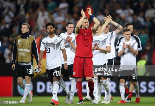 Germany acknowledge their fans after winning the UEFA Euro 2020 Qualifier match between Germany and Estonia at Opel Arena on June 11, 2019 in Mainz,...