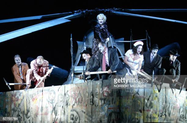 Actors of the Saxony State Opera rehearse a scene of the opera The Rise and Fall of the City of Mahagonny by dramatist Bertolt Brecht and composer...