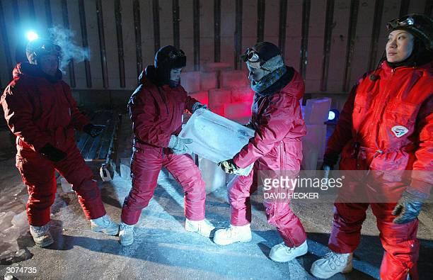 Actresses Daphne van Tongeren Ioana Christescu Birgit Wieger and Miyoko Urayama carry a block of ice during a rehearsal of their play Eismitte in a...