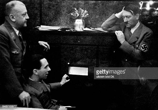 Germany Adolf Hitler and Jospeh Goebbels at the Berghof listening to the radio on the occasion of the plesbicite on the reunion of the Saarland with...