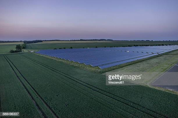 germany, aerial view of solar fields at nothern harz foreland at evening twilight - saxony anhalt stock pictures, royalty-free photos & images