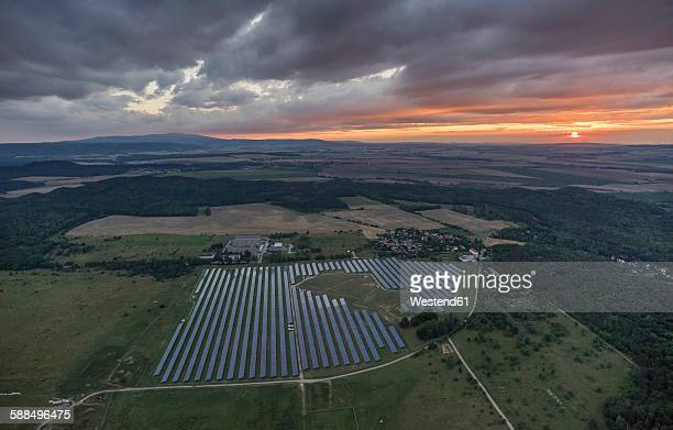 Germany, aerial view of solar fields near Halberstadt at evening twilight